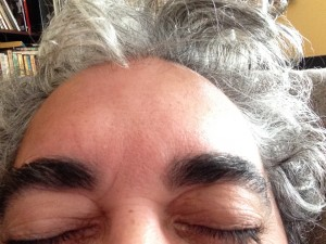 The hair is much more grey than the eyebrows.  Also, my forehead is not the big.  Kids these days and their cameras.